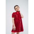 Платье трапеция из красных пайеток с бантом - шарфом.